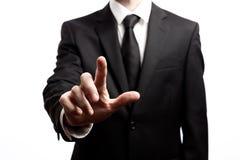 Geschäftsmann, der seinen Finger auf einem weißen Hintergrund zeigt Stockfotos