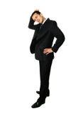 Geschäftsmann, der seinen Kopf, konfus löscht lizenzfreie stockfotos