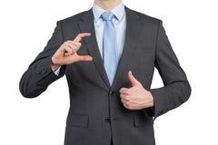 Geschäftsmann, der sich Daumen zeigt Stockbild