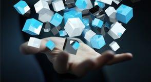 Geschäftsmann, der sich hin- und herbewegendes blaues glänzendes Würfelnetz 3D renderin hält Stockfoto