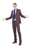 Geschäftsmann, der Sie begrüßt stockfotos