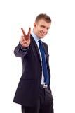 Geschäftsmann, der Sieg gestikuliert Stockbild