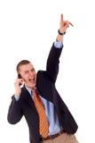 Geschäftsmann, der am Telefon gewinnt Lizenzfreie Stockfotografie