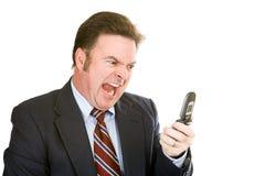Geschäftsmann, der in Telefon kreischt Lizenzfreie Stockfotos