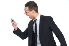Geschäftsmann, der am Telefon schreit lizenzfreie stockfotos