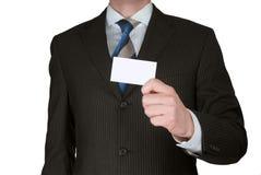 Geschäftsmann, der unbelegte Karte anhält Stockfoto