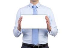Geschäftsmann, der unbelegtes Papier anhält Stockfotografie