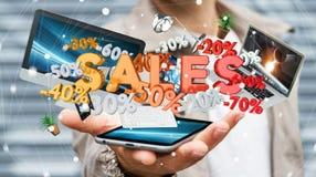 Geschäftsmann, der Verkaufsikonen über seiner Wiedergabe des Telefons 3D hält Stockbild