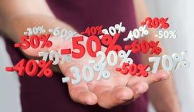 Geschäftsmann, der Verkaufsikonen in seiner Wiedergabe der Hand 3D hält Lizenzfreie Stockbilder