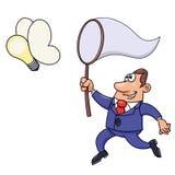 Geschäftsmann, der versucht, eine Glühlampeidee zu fangen Lizenzfreie Stockfotografie