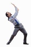 Geschäftsmann, der virtuelle Hindernisse wegdrückt Stockfoto