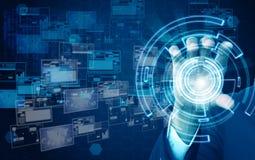 Geschäftsmann, der virtuelle Technologie hält Stockbilder