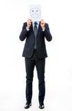 Geschäftsmann, der weiße Karte mit traurigem Gesicht auf ihm hält Lizenzfreies Stockbild