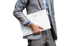 Geschäftsmann, der weißen Laptop hält Lizenzfreie Stockbilder