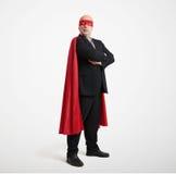 Geschäftsmann, der wie Superheld trägt Stockfoto