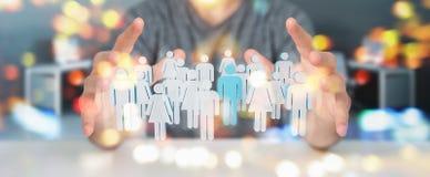 Geschäftsmann, der Wiedergabe der Gruppe von Personen 3D hält Lizenzfreie Stockfotos
