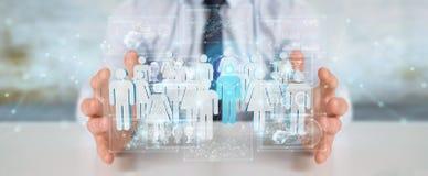 Geschäftsmann, der Wiedergabe der Gruppe von Personen 3D hält Stockfoto