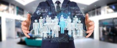 Geschäftsmann, der Wiedergabe der Gruppe von Personen 3D hält Lizenzfreie Stockbilder