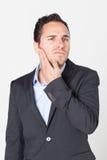 Geschäftsmann, der Zahnschmerzen hat stockfoto