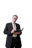 Geschäftsmann, der zum Notizbuch schreibt Stockbilder