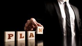 Geschäftsmann in einem einfachen Unternehmensplan-Konzept Stockfoto