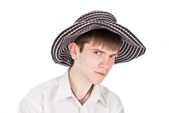 Geschäftsmann in einem Hut auf einem Isolathintergrund Lizenzfreie Stockfotos