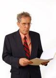 Geschäftsmann in einer Klage Stockbild