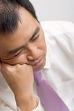 Geschäftsmann ermüdet Stockbild