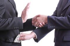 Geschäftsmann geben Geld für Korruption etwas aber ein anderes peop Lizenzfreie Stockfotos
