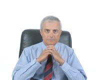 Geschäftsmann gesetzt am Schreibtisch Lizenzfreie Stockfotos