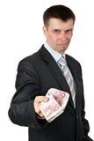 Geschäftsmann gibt beiläufig den Euro Stockfotos