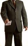 Geschäftsmann gibt Geld Lizenzfreie Stockbilder