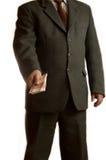 Geschäftsmann gibt Geld Stockbilder