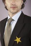 Geschäftsmann With Gold Star auf Klage lizenzfreies stockbild
