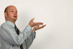 Geschäftsmann hält Darstellung an Stockfotos