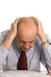Geschäftsmann hält für einen Kopf Lizenzfreie Stockfotografie