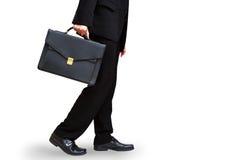 Geschäftsmann-Handholdingaktenkoffer Stockfotos
