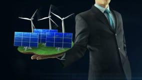Geschäftsmann hat an Hand grünes Energiekonzeptgestaltanimationssonnenkollektor- und -windmühlenschwarzes stock abbildung