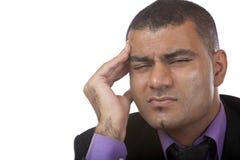 Geschäftsmann hat Kopfschmerzen des Druckes Stockfoto