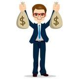 Geschäftsmann-Holding Dollar Money-Taschen Lizenzfreie Stockfotos