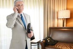 Geschäftsmann Hotel Room Lizenzfreies Stockfoto