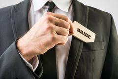 Geschäftsmann im einfachen Bestechungsgeld-Konzept Lizenzfreie Stockbilder