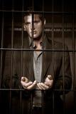 Geschäftsmann im Gefängnis stockbild