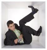 Geschäftsmann im Würfel lizenzfreies stockfoto