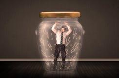 Geschäftsmann innerhalb eines Glasgefäßes mit Blitzzeichnungskonzept Stockfotografie