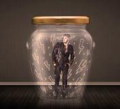 Geschäftsmann innerhalb eines Glasgefäßes mit Blitzzeichnungskonzept Lizenzfreie Stockfotografie