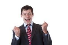 Geschäftsmann jubilates glücklich mit den chlenched Fäusten Stockbild
