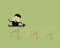 Geschäftsmann Jumping Over Hurdle Lizenzfreies Stockfoto
