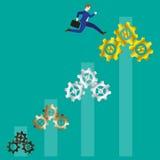 Geschäftsmann-Jumping To Gold-Zahnräder Lizenzfreies Stockfoto