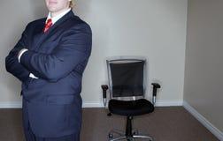 Geschäftsmann-leerer Stuhl lizenzfreie stockbilder